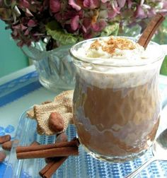 Coffee Punch 1 pint milk 2 quarts strong coffee, cooled 2 teaspoons vanilla extract 1/2 cup sugar 1 quart vanilla ice cream 1/2 pint whipping cream ground nutmeg  Directions: Leave ice cream out of the freezer until well softened. Combine milk, coffee, vanilla and sugar. Blend well. Whip cream until thick. Place softened ice cream in a punch bowl. Pour in coffee mixture. Top with whipped cream and dust with nutmeg.