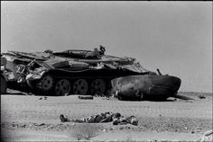 Egyptian tank crewman lies dead beside his tank in the Sinai Desert, Day 5 of the Six-Day War, 1967.