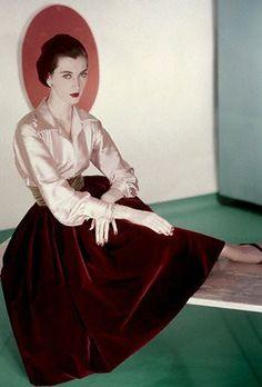 1952 Dovima in pale pink satin blouse & dark red velvet skirt early 50s silk blouse red velvet skirt classic elegant supermodel vintage fashion style print ad color
