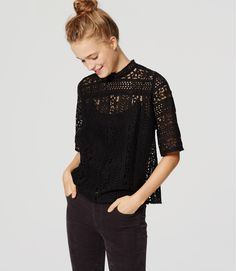 Lined up in mixed floral lace, this femme piece is a romantic dream. Picot-edged mock neck. Elbow sleeves. Back button keyhole.