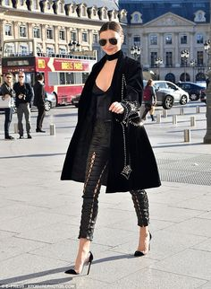 Strutting her stuff! The mother-of-one looked racy in lace-up leather trousers earlier in the day