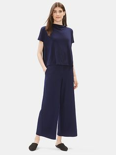 A flattering wide-leg ankle pant, designed with a higher waist. Easy and fluid in a lightweight version of our washable, packable stretch crepe. Wrap Pants, Ankle Pants, Online Purchase, Eileen Fisher, Fashion Pants, Stretches, Wide Leg, Jumpsuit, Dresses For Work