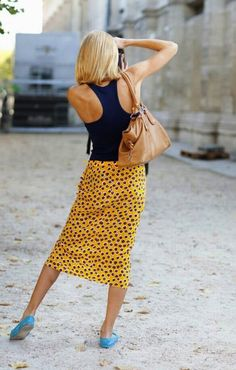 racerback tank, printed midi vintage skirt, bright, contrasting color flats. source: Riches for Rags