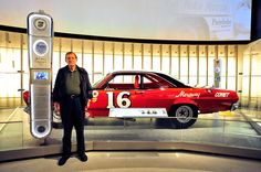 NASCAR Hall of Fame member Bud Moore poses beside his 1966 #16 Mercury Comet, during the Hall of Honor unveiling at the NASCAR Hall of Fame on May 24, 2011 in Charlotte, North Carolina.