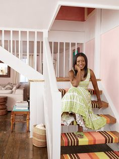 """Stripes add preppy zip to the floors—including a riotous chartreuse-and-orange rug that Reese cut into individual runners for her free-floating stairs. """"I attached them with Velcro,"""" she says, """"so I can wash them from time to time. Open Stairs, Floating Stairs, White Stairs, New York Homes, New Homes, Country Living Magazine, Home Budget, Orange Rugs, Carpet Stairs"""