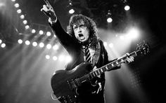 AC/DC, the famous Australian hard rock band, was formed in by Angus Young and his older brother, Malcolm Young. Angus Young, Ac Dc, Bon Scott, Fender Telecaster, Woodstock, Hard Rock, Beatles, Phil Rudd, The Kinks