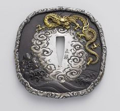A well crafted Tsuba made better with the engraved art.