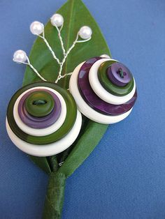 Groomsmen Button Boutonniere 2 | Flickr - Photo Sharing! My OH always saying a button hole is for a button to go in, this will keep him quiet!