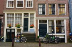 a symbol you will spot everywhere in Amsterdam. Is it related to the city's liberal views? Liberal Views, Amsterdam Holland, Traditional House, Netherlands, Dutch, Places To Visit, City, Outdoor Decor, Backpack