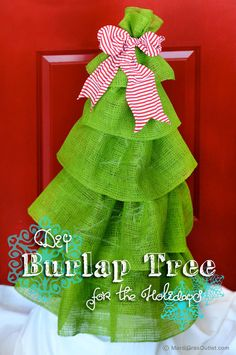Burlap Tree created with a Tomato Cage-- I could see this done in different colors for other holidays... decorate with in purple burlap with a yellow bow and hanging eggs for Easter, a blue tree iwth red bow and pinned on small flags on for Independence Day, Pink and red with pinned hearts for Valentines, etc.