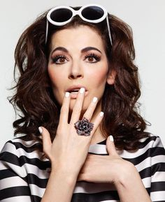 Nigella Lawson • this woman is my hero. she puts the kitsch in kitchen and does so looking f*n fabulous.