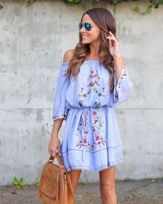 We love the floral embroidery on our Flamenco Beach Embroidered Dress in this blue chambray effect. The elastic off the shoulder neckline and 3/4 sleeves keep y