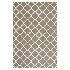 Add a pop of pattern to your living room or den with this hand-hooked wool rug, showcasing a trellis motif in blue and ivory.   Pro...