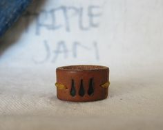 Hey, I found this really awesome Etsy listing at https://www.etsy.com/listing/171992115/brown-leather-hand-stitched-ring-three