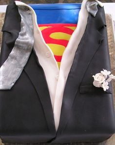 Superman Groom's Cake 1 - not a Superman fan, but I like the idea of a Groom's Cake in this style. Just with a different hero undershirt. Iron Man comes to mind as a replacement.