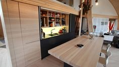 Domespace project:The design brief was a black, hidden kitchen. Sliding bench top in solid maple. The staircase in solid walnut offers plenty of storage. Hidden Kitchen, Dome House, Kitchen Design, Storage, Modern, Table, Furniture, Architecture, Home Decor