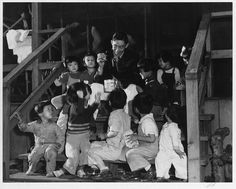 Mr. Matsumoto with a group of children, Manzanar Internment camp for Japanese-American citizens,1943  Photograph by Ansel Adams via The Library of Congress.