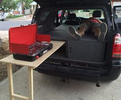 I helped my little brother build a camper conversion for his 4Runner this weekend. It is a three part assembly with a cabinet door, slide out table, under storage...