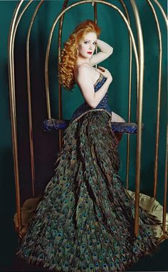 Burlesque Peacock Gown w/ Feathered Train; Model (Catherine D'Lish) on swing in Gilded Cage.