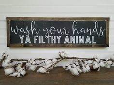 This is a hand painted Wash your hands, ya filthy animal sign. It is perfect for your farmhouse style home! Want is distressed more? Less? Just ask! Need a custom size? Message us! All signs are custom made, distressed, and hand painted. No two signs are the same. Each frame is hand