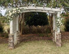With roses, hydrangea, stock, ranunculus and eucalyptus greenery.