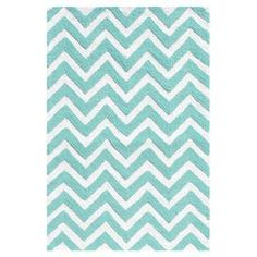 Indoor/outdoor rug with teal chevron motif.  Product: RugConstruction Material: UV polypropyleneColor: Teal and whiteFeatures: Suitable for indoor and outdoor use  Note: Please be aware that actual colors may vary from those shown on your screen. Accent rugs may also not show the entire pattern that the corresponding area rugs have.Cleaning and Care: Spot clean with mild soap and water with garden hose