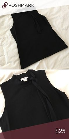 Black sleeveless Ann Taylor top. Black sleeveless AT top. Size small. Neck tie. Barely worn. Ann Taylor Tops Blouses