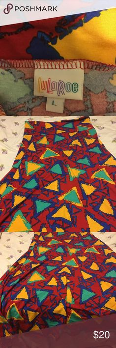 LuLaRoe bright geometric maxi skirt, worn once LuLaRoe bright red yellow and blue geometric print maxi skirt! Wear as strapless full length dress or as maxi skirt. I wore once or twice only, has been machine washed on casual.  😺🐶pet friendly home 🚭non-smoking home 📦 fast shipping LuLaRoe Skirts Maxi