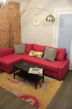 Home Sweet Apartment with IKEA Friheten sofa in deep pink, fun rug from Overstock