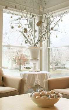 Holiday decor: Use what you have for the holidays--urn with decorated branches--great for a small house or apartment.