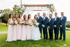 San Diego wedding at lomas santa fe country club bride strapless tulle ball gown with beaded bodice and purple sash with groom navy blue suit with matching vest and white dress shirt with white bow tie and white floral boutonniere with bridesmaids long blush pink dresses with groomsmen navy blue suits with white bow ties