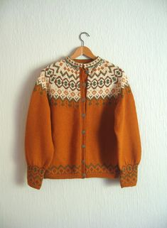 Vintage Norwegian traditional hand knit cardigan wool sweater made by Klover Hustet. Wonderful fall colors: pumpkin orange, olive, brown and cream. Vintage Sweaters, Wool Sweaters, Fair Isle Knitting, Hand Knitting, Norwegian Knitting, Pullover Mode, Sweater Making, Wool Cardigan, Sweater Fashion