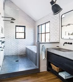 In the master bathroom, a modern farmhouse aesthetic took an industrial bent with brick walls, a concrete shower floor, and metal windows—the latter providing a view of horses. dusche Room Envy: At Serenbe, a master bath with a modern farmhouse aesthetic Room Envy, House Bathroom, Master Bathroom Decor, Japanese Bathroom, Concrete Shower, Modern Farmhouse Style, Farmhouse Master Bathroom, Bathroom Design, Bathroom Renovation