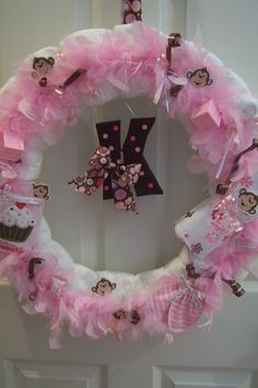 diaper wreath. with feathers.