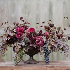 death becomes her. grapes, roses, fall dark arrangement