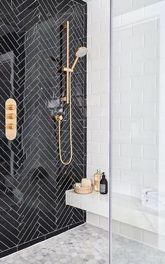 Beautiful black and white walk in shower design, with herringbone and mosaic tile #bathroomideas #homestyle