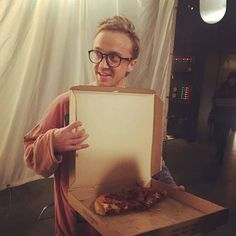 two things that makes women happy - pizza and Tom Felton