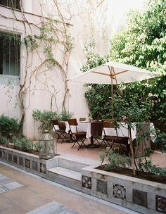 Patio retaining wall with planter