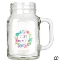 Serve your guests cold, southern sweet tea in a mason glass jar decorated with beachy #tropical flowers