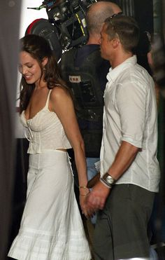 The set: Angelina Jolie and Brad Pitt did start a romance on the set of Mr & Mrs Smith, her bodyguard told UsWeekly; here they are seen on set in 2004 in LA