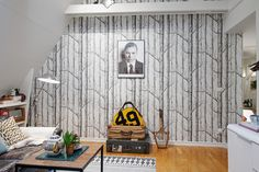 Tree print wallpaper adds texture and depth to this modern apartment. Small Apartments, Small Spaces, Living Area, Living Room, Loft Stairs, Ideas Prácticas, Beautiful Places To Live, One Bed, Apartment Design