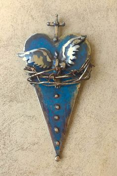 Sacred hearts made of junkyard metal by artist Catherine Partain. Visit my shop on Etsy! https://www.etsy.com/shop/CrossesByCatherine