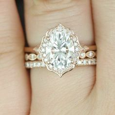 The Mae halo engagement ring from Rosados Box on Etsy showcases moissanite and diamonds and is set in 14k rose gold.