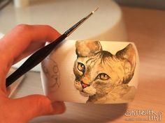 Working at my sphinx cat bracelet.
