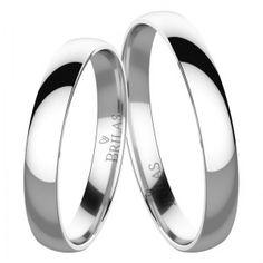 Velmi jednoduché klasické snubní prsteny vytvořené z bílého zlata. Jejich povrch je celý lesklý bez zdobení. Dámský model je shodný jako pánský, bez kamenů. Šíře činí 2,5 mm.