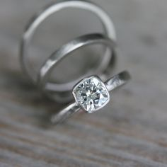 Cushion Cut Moissanite Engagement Ring in 14k Palladium White Gold, Solitaire Cushion Cut Wedding Ring. $1,348.00, via Etsy.