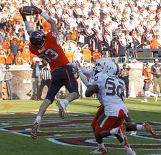 Jake McGee catches the game-winning touchdown pass from Michael Rocco with 0:06 remaining. Virginia beat Miami 41-40.