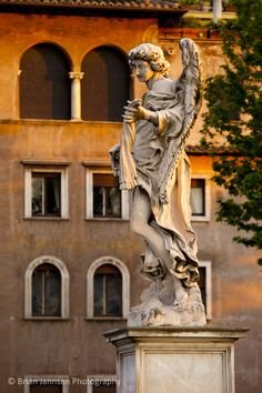 Angel statue along Ponte Sant Angelo, Rome Lazio, Italy. © Brian Jannsen…