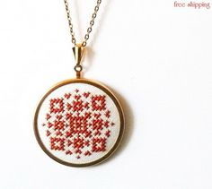 Hand embroidered necklace amber geometrical ornament on white