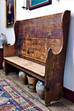 Skinner's - The Personal Collection of Lewis Scranton, Auction 2897M. May 21, 2016. Lot: 118 (in situ).  Estimate: $4,000-6,000.  Realized: $11,000.   Description:  Pine Settle, New England, 18th century, rectangular back joining cutout ends ending in pointed hand holds, all on a semi-arched base, old surface, ht. 53, lg. 60, dp. 16 in.